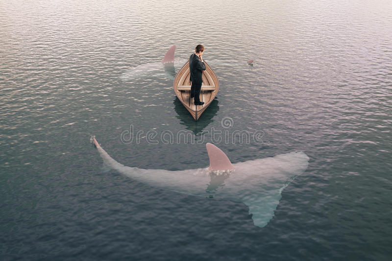 Бизнесмен и акулы стоковые изображения