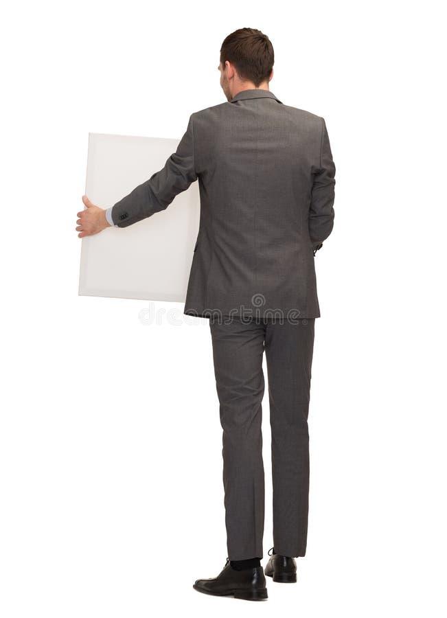 Бизнесмен или учитель с белой доской от задней части стоковое изображение
