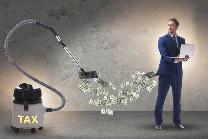 Бизнесмен и пылесос сосать деньги из его стоковые фотографии rf