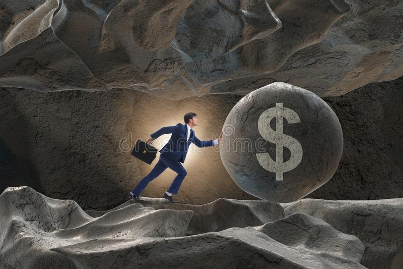 Бизнесмен нажимая доллар подписывает внутри концепцию дела стоковая фотография