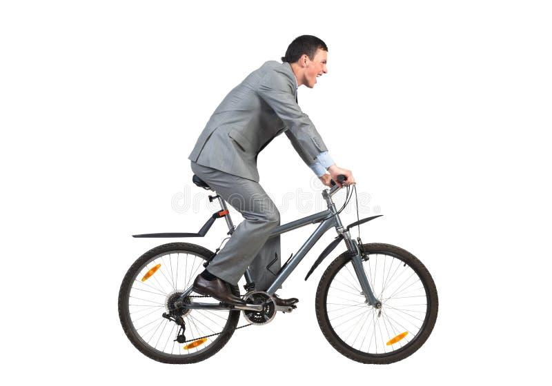Бизнесмен на спешности велосипеда, который нужно работать стоковые изображения