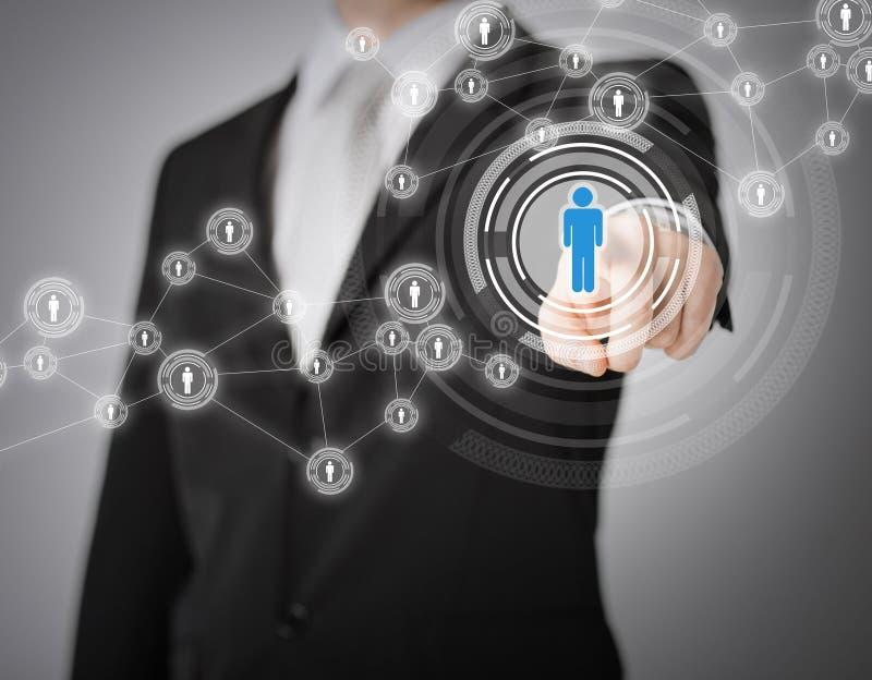 Бизнесмен отжимая кнопку с контактом стоковое изображение rf