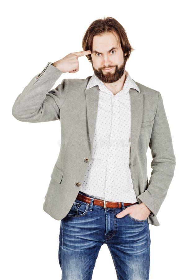 Бизнесмен показывать с его пальцем против спрашивать виска стоковое фото rf