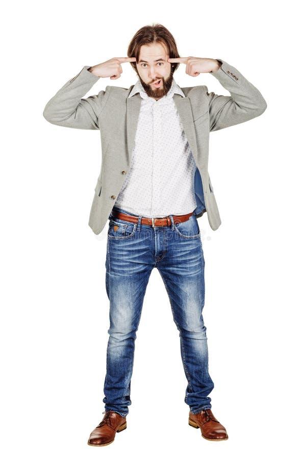 Бизнесмен показывать с его пальцем против спрашивать виска стоковые изображения