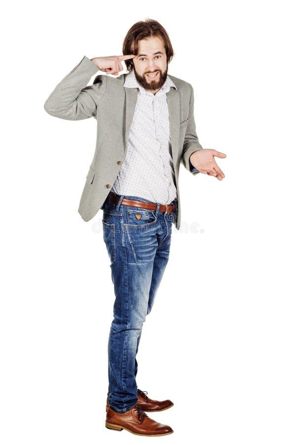 Бизнесмен показывать с его пальцем против спрашивать виска стоковые изображения rf