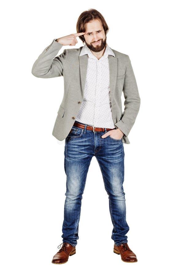 Бизнесмен показывать с его пальцем против спрашивать виска стоковое фото