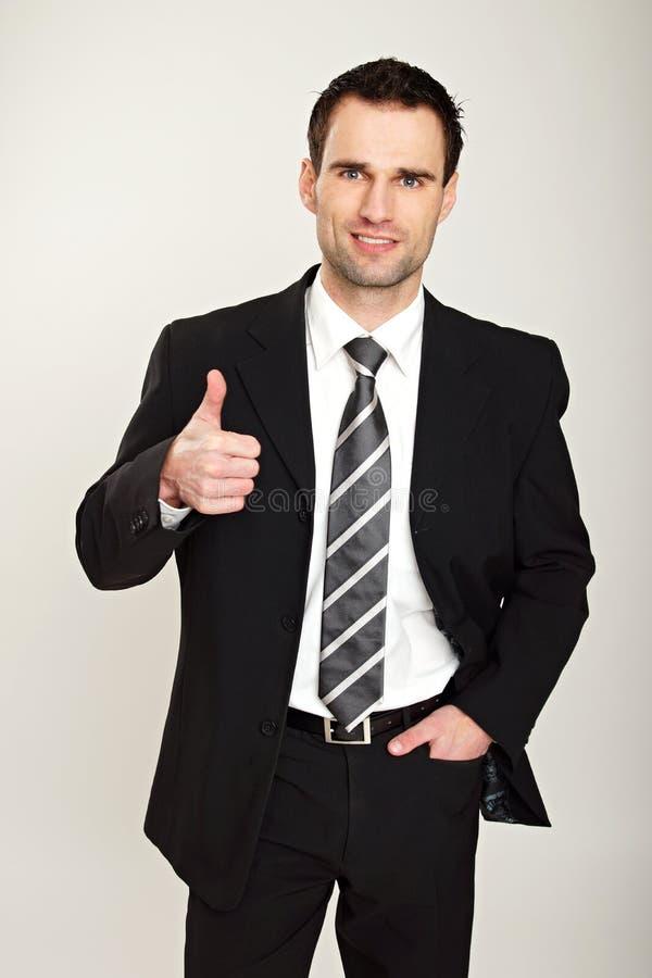 Бизнесмен показывая большой палец руки вверх стоковые фотографии rf