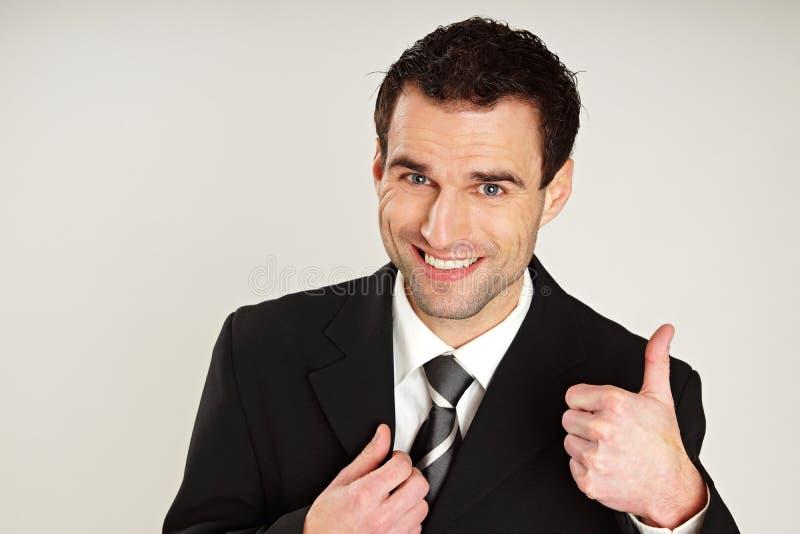 Бизнесмен показывая большой палец руки вверх стоковое изображение rf