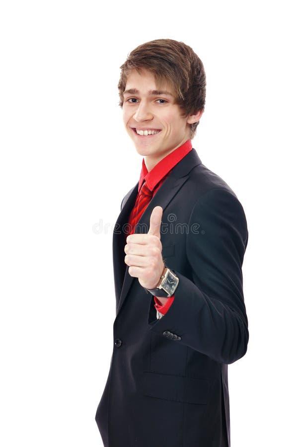 бизнесмен показывая большой пец руки знака вверх по детенышам стоковые изображения rf