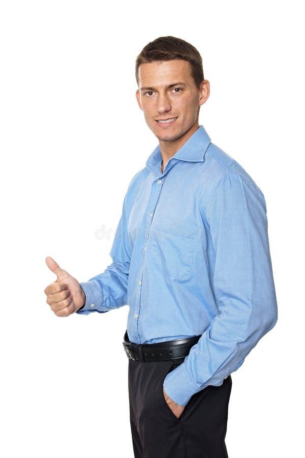 бизнесмен показывая большой пец руки знака вверх по детенышам стоковая фотография