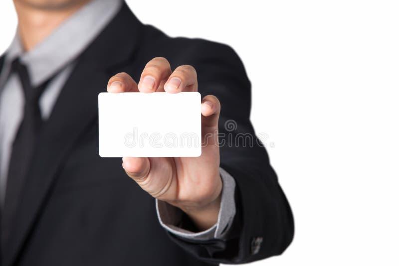 Бизнесмен показывая его карточку имени с космосом для экземпляра стоковое фото rf