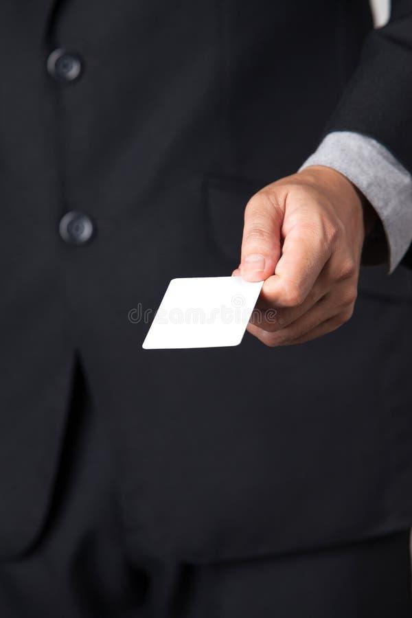 Бизнесмен показывая его карточку имени стоковое фото rf
