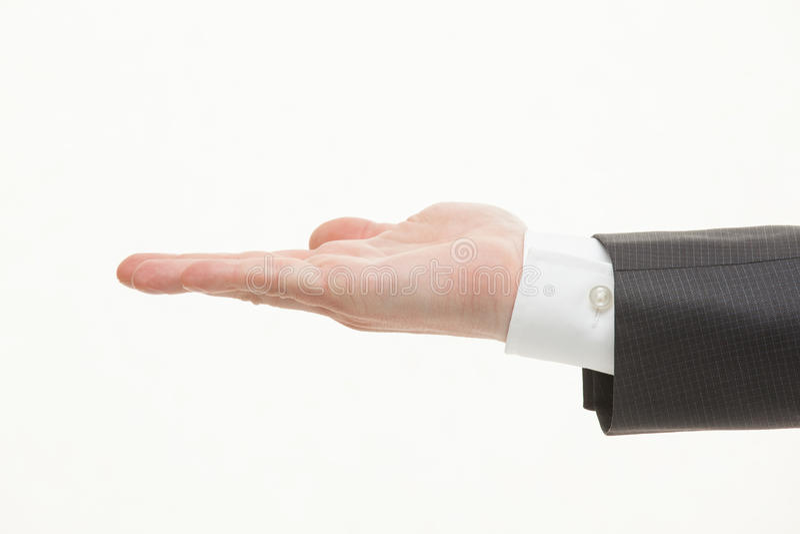 Бизнесмен показывая пустую ладонь стоковое фото