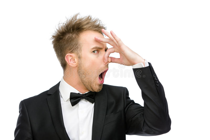 Бизнесмен покрывая его нос стоковое изображение