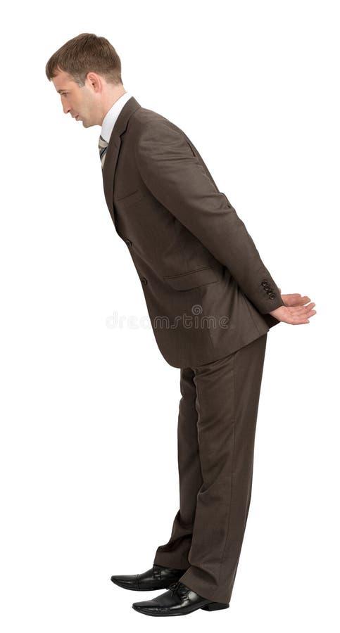 Бизнесмен положился вперед с пустыми руками позади стоковое фото