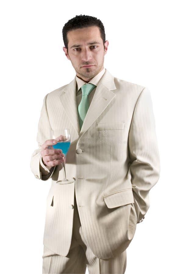 бизнесмен празднуя белизну костюма питья стеклянную стоковая фотография