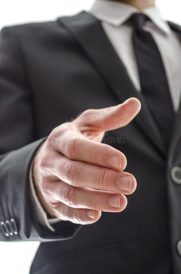 Бизнесмен предлагая рукопожатие стоковые изображения rf