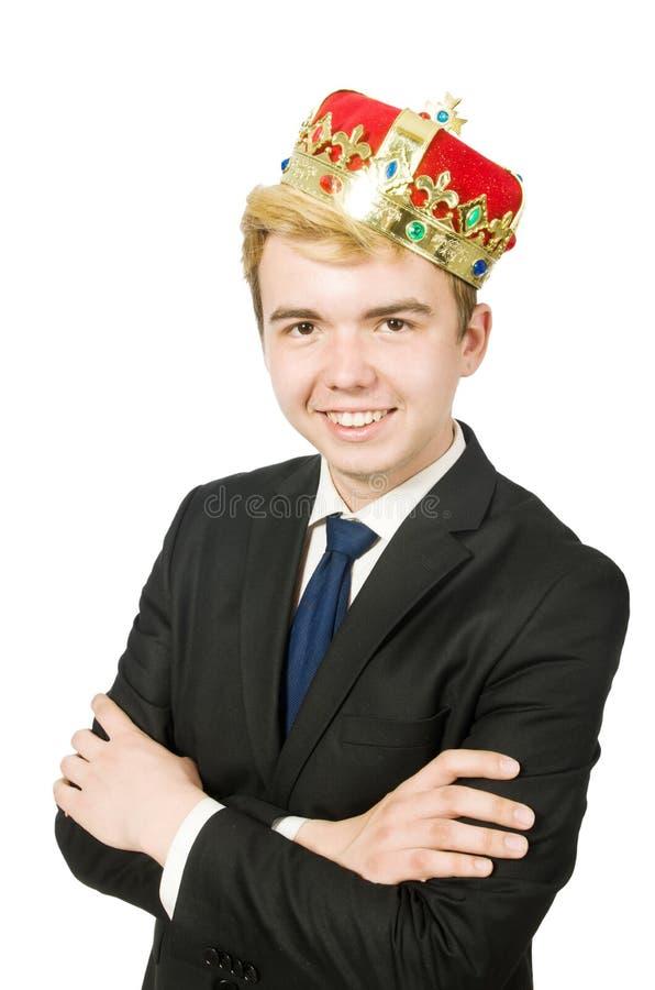 Бизнесмен при изолированная крона стоковое фото