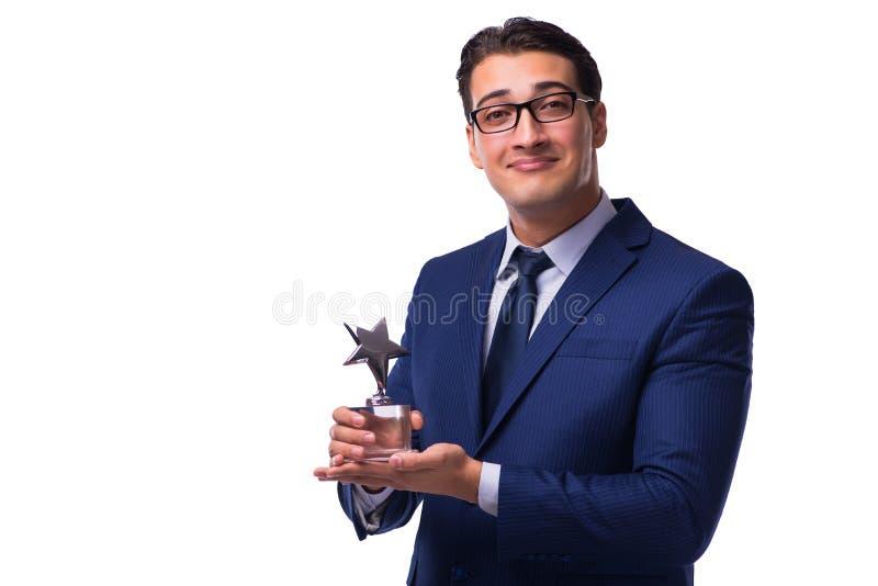 Бизнесмен при награда звезды изолированная на белизне стоковые изображения