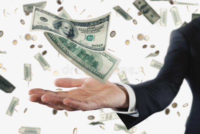 Бизнесмен при ненастные банкноты изолированные над белой предпосылкой Концепция успеха, карьеры и большого дохода стоковое фото