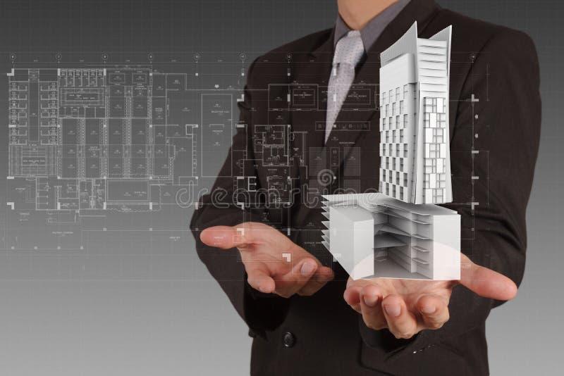 Бизнесмен рисует развитие здания стоковые изображения rf