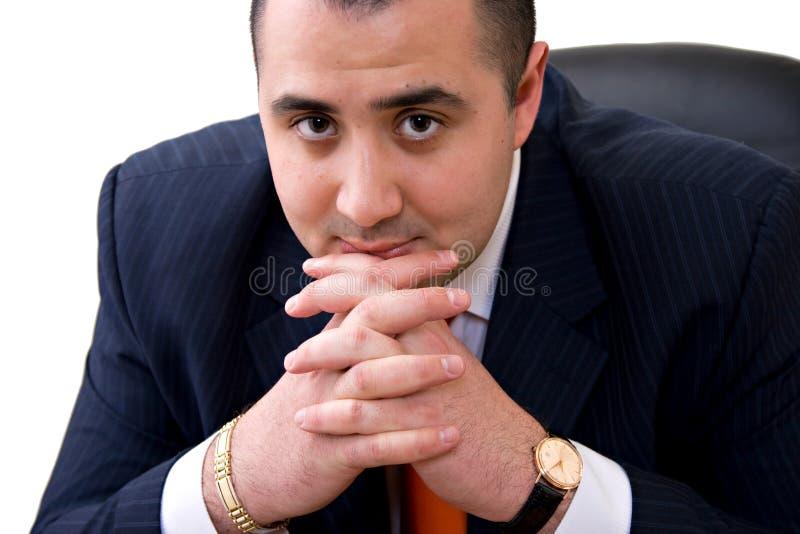 Бизнесмен сидя на стуле стоковые фото