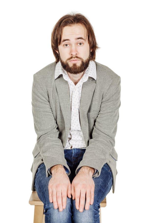 Бизнесмен сидя с представлять проигравшего депрессии эмоции, fac стоковое фото