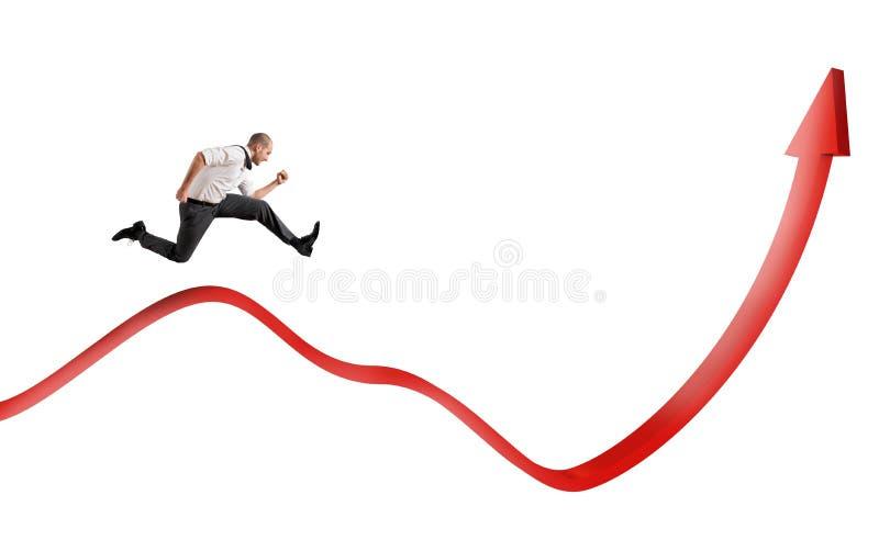Бизнесмен скачет вверх стоковое изображение