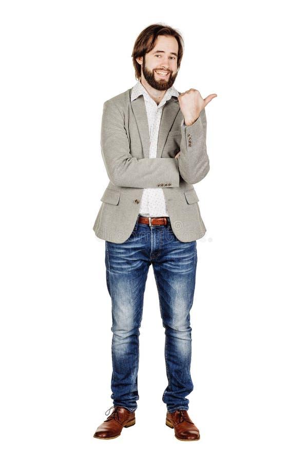 Бизнесмен смотря и указывая жест пальца счастье, g стоковые фото