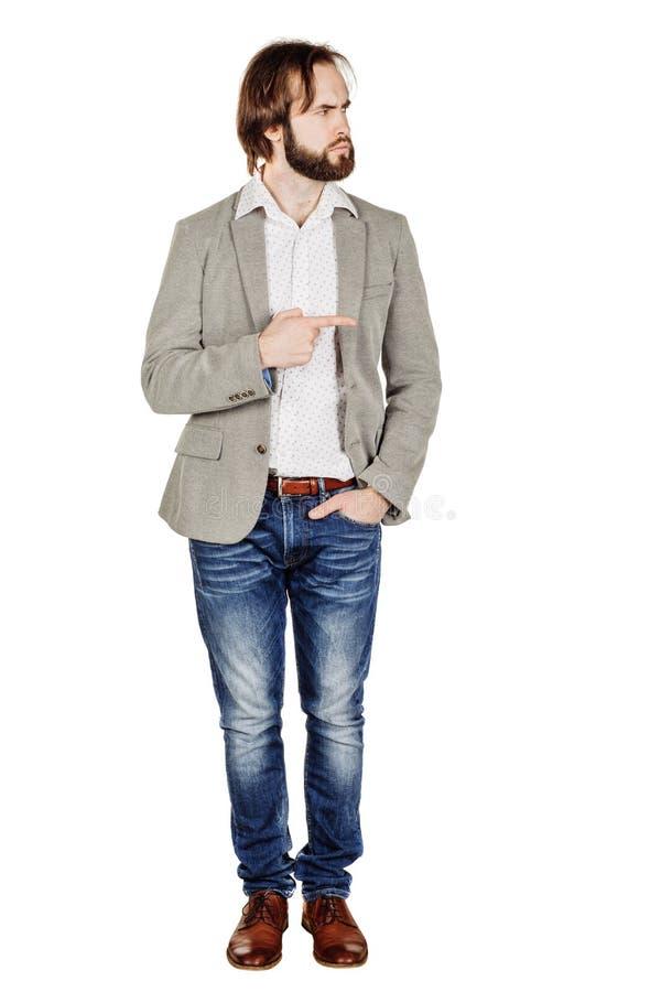 Бизнесмен смотря и указывая жест пальца счастье, g стоковое фото