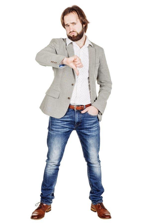 Бизнесмен смотря камеру и показывая его большой палец руки вниз пока s стоковые изображения
