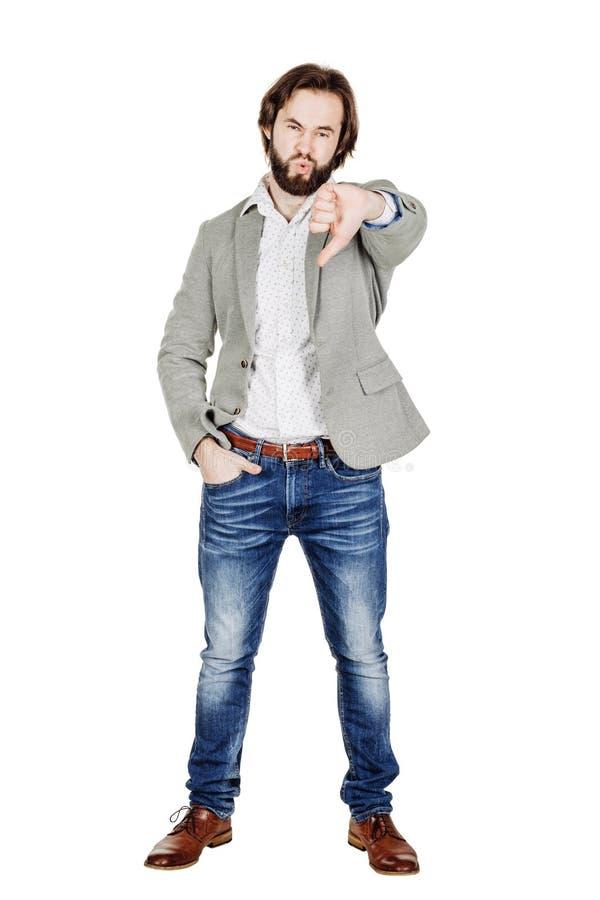 Бизнесмен смотря камеру и показывая его большой палец руки вниз пока s стоковая фотография rf