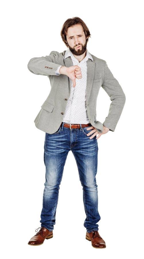 Бизнесмен смотря камеру и показывая его большой палец руки вниз пока s стоковое изображение rf