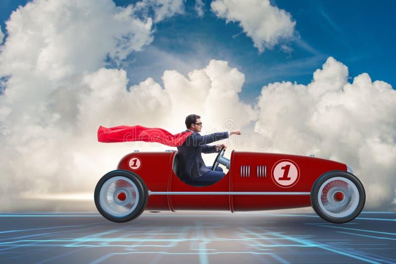 Бизнесмен супергероя управляя винтажным родстером стоковая фотография rf
