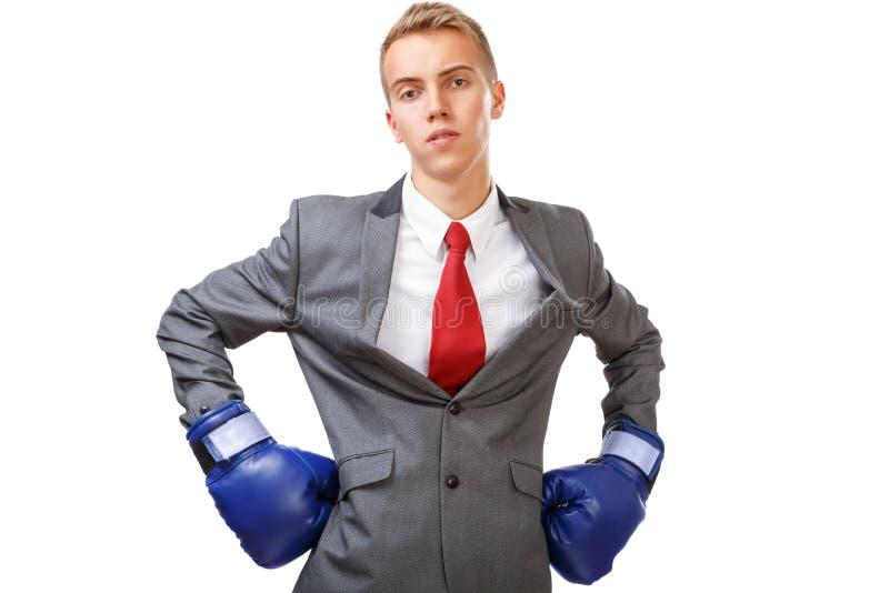 Бизнесмен с голубыми перчатками бокса стоковые фото