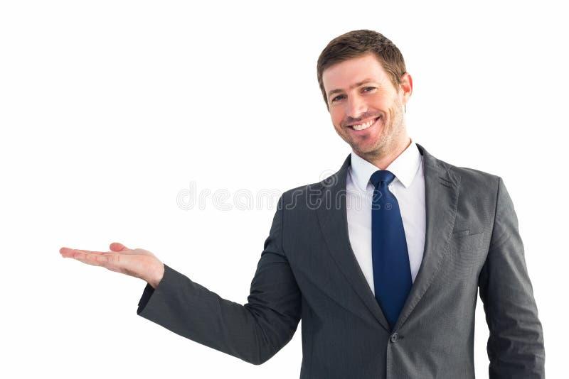 Бизнесмен с его рукой вне стоковое изображение rf