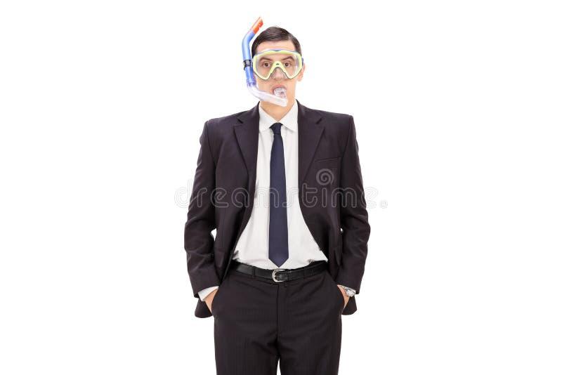 Бизнесмен с маской подныривания стоковое изображение