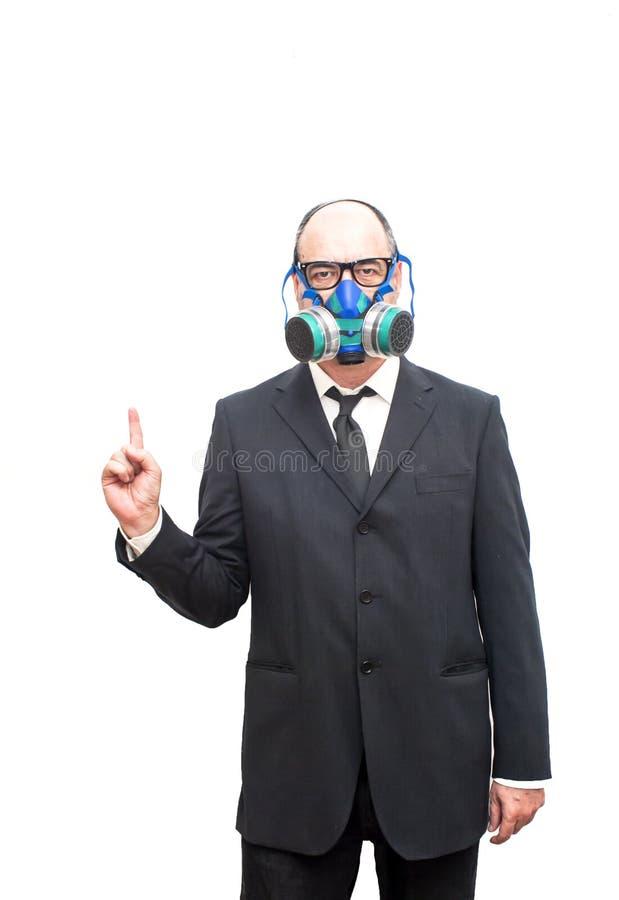 Бизнесмен с маской противогаза указывая его указательный палец вверх стоковые изображения rf