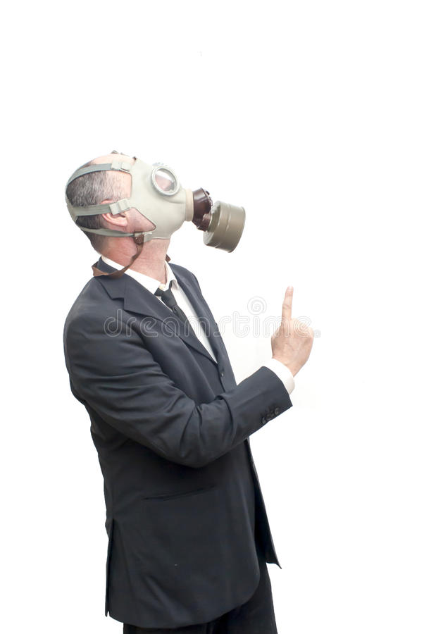 Бизнесмен с маской противогаза указывая его указательный палец вверх стоковое фото rf