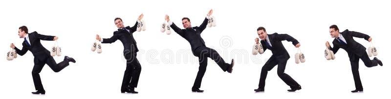 Бизнесмен с мешками денег изолированными на белизне стоковое фото