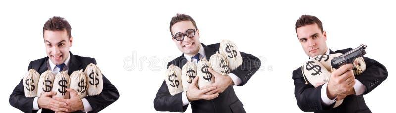 Бизнесмен с мешками и личным огнестрельным оружием денег стоковые фотографии rf