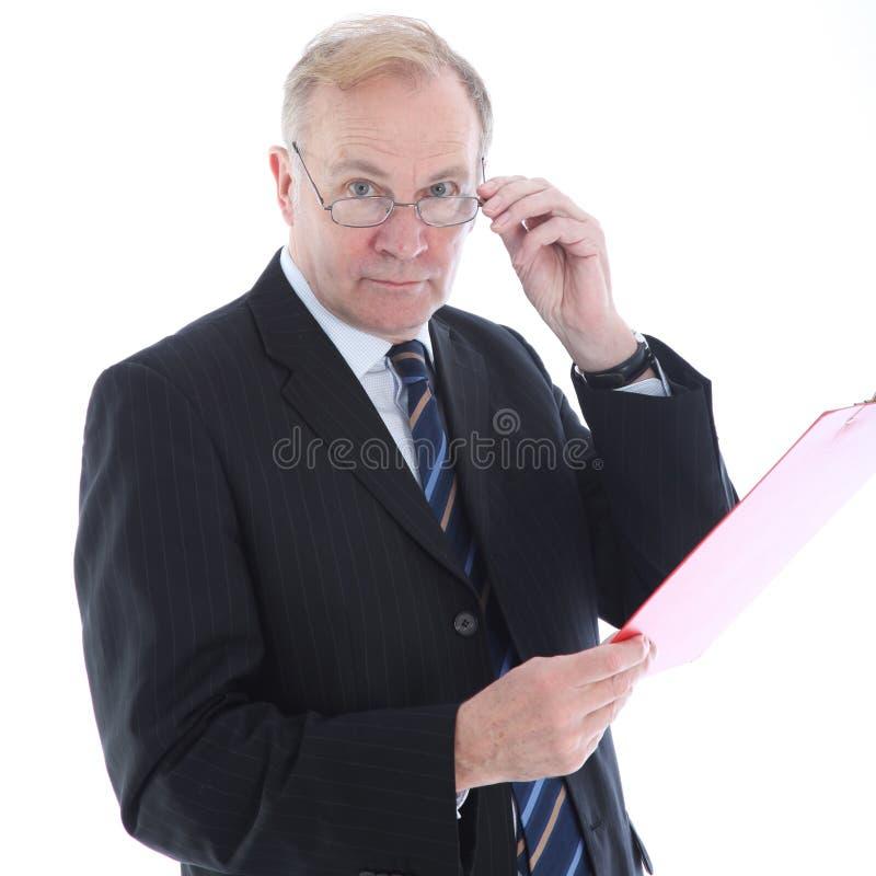 Бизнесмен с определять взгляд стоковая фотография