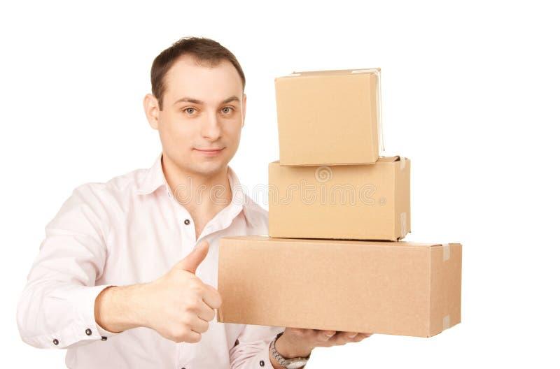 Бизнесмен с пакетами стоковое изображение rf
