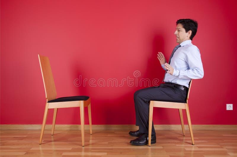 Бизнесмен с страхом стоковая фотография