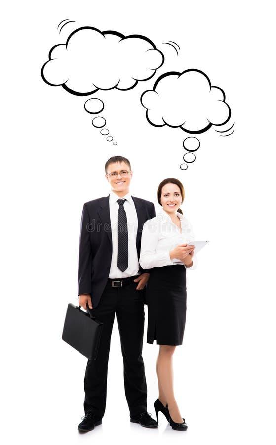 Бизнесмен с случаем и его женский коллега с таблеткой стоковое фото