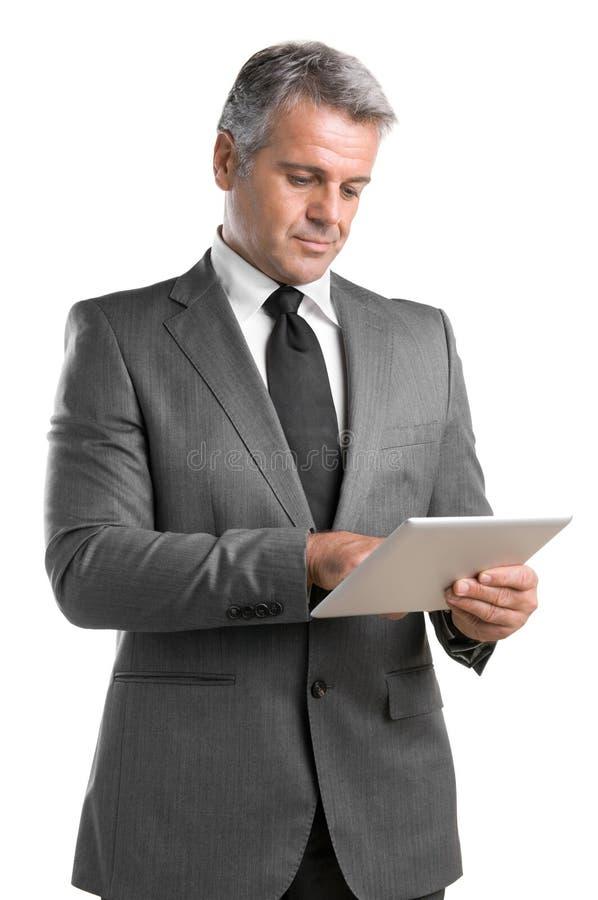 Бизнесмен с таблеткой стоковое фото