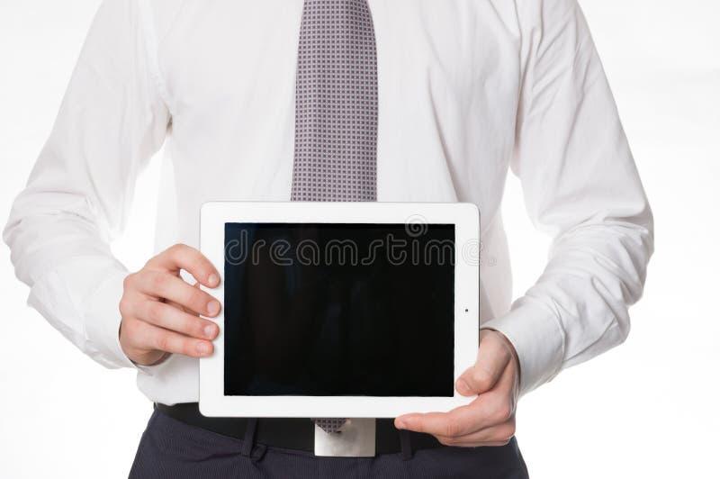 Бизнесмен с таблеткой стоковое фото rf
