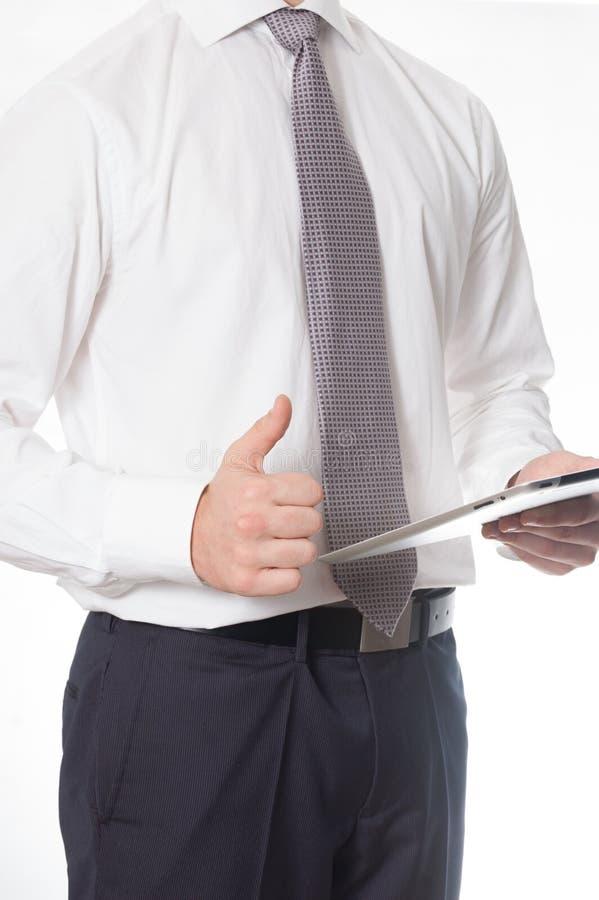 Бизнесмен с таблеткой стоковые фото