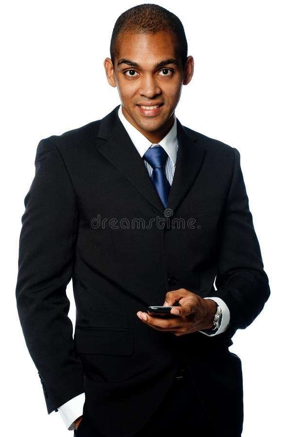 Бизнесмен с телефоном стоковое фото rf