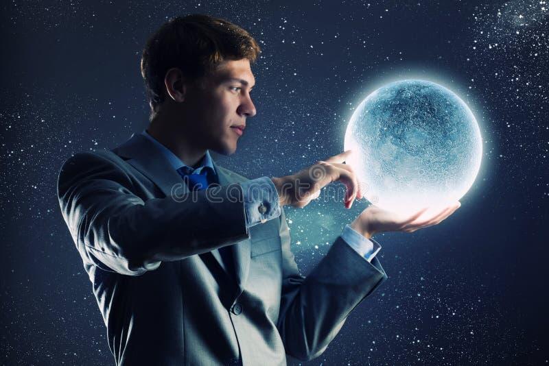 Download Бизнесмен с луной стоковое изображение. изображение насчитывающей moonshine - 41650271